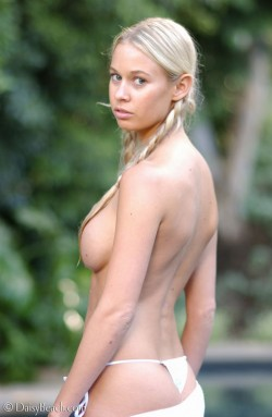 Sarah from Daisy Beach topless with braided pigtails