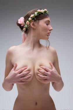 Femjoy Ashley holding her breasts