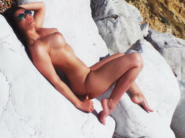Afyzel sunbathing naked