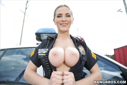 police officer Molly Jane squeezing her boobs together