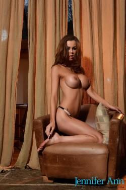 topless Jennifer Ann shows her enhanced boobs